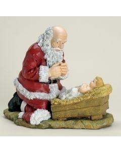 Kneeling Santa Musical Figurine